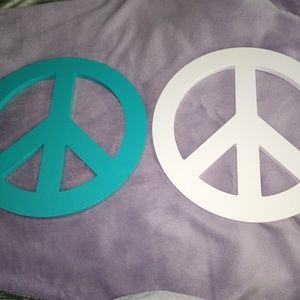 Peace sign wall hangings.